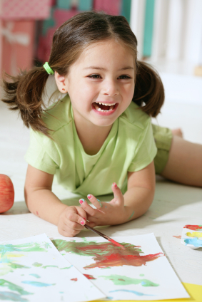 Girl with paint - Pediatric Dentist in Cary, NC